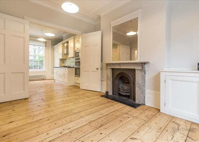 Islington interior with knock-through, stripped pine flooring, period fireplace ...